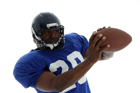 nfl: Football Player shot on a white background