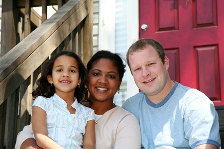 A mixed race mother, father and daughter