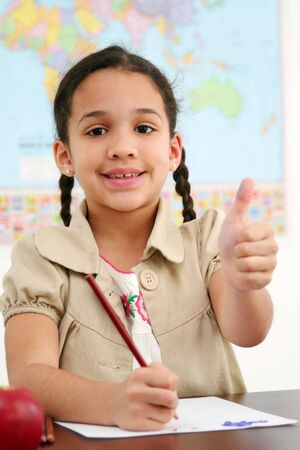 Student at school with her thumb up Imagens - 13299670
