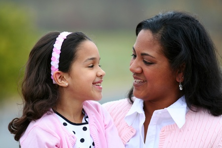 Mother and daughter together laughing while talking photo