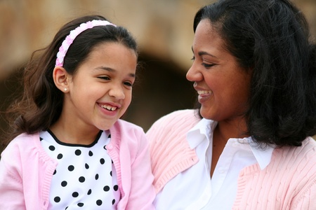 children talking: Mother and daughter together laughing while talking