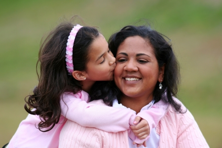 loved: Mother and daughter together in a field