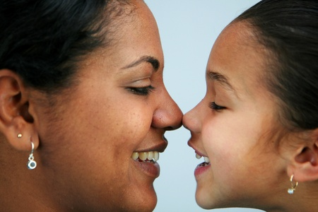 rubbing noses: Mom and daughter with faces together Stock Photo