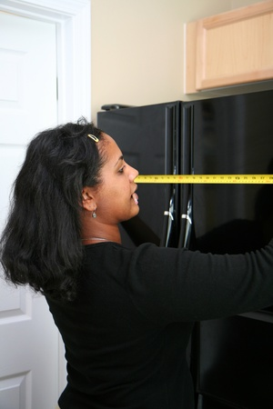 Woman measuring in the kitchen Stock Photo