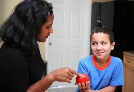 Family in kitchen talking photo