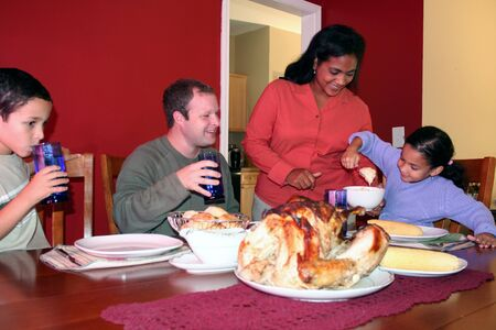 Family having thanksgiving dinner photo