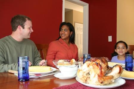 Family having thanksgiving dinner photo