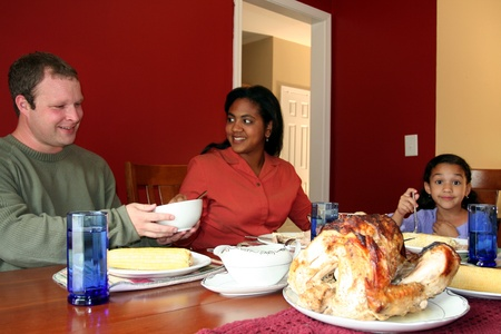 Family having thanksgiving dinner Stock Photo - 13298715