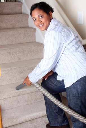 household chore: Woman cleaning in her house with a vacuum cleaner