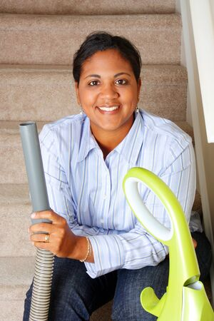 vacuum cleaner: Woman cleaning in her house with a vacuum cleaner