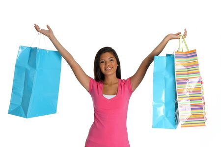 Teen girl shopping with bags on white background photo