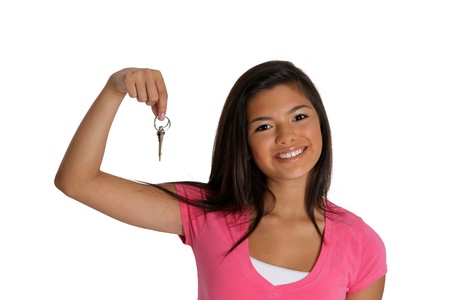 Teenage girl set against a white background holding keys