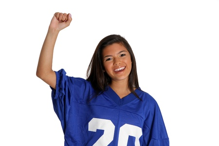 Teen cheering for her team in a jersey photo