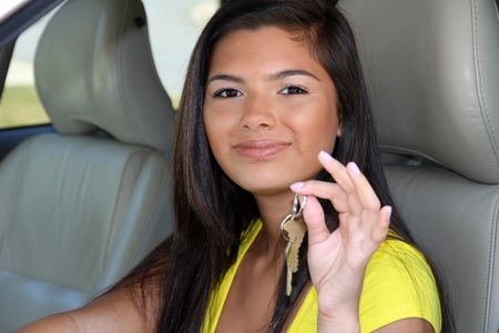drivers seat: Teen holding up keys to her new car Stock Photo