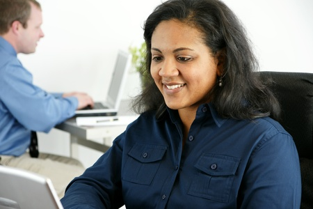 Businesswoman in her office Stock Photo - 13294135