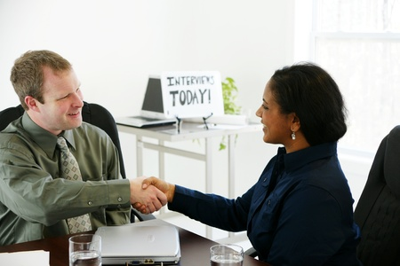 african american handshake: Interview in an office Stock Photo