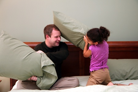 family fight: Father and Daughter having a pillow fight