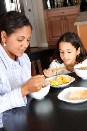 kids eating healthy: Family eating their breakfast sitting at the table