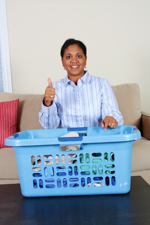 Woman doing the laundry in her home