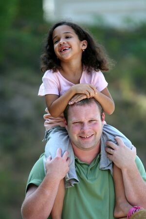interracial love: Father with Daughter Stock Photo
