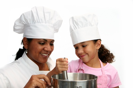 Woman with child teaching her to cook Stock Photo