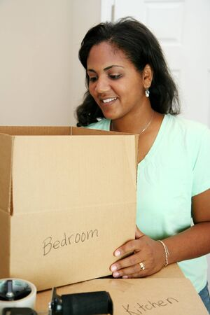 Family moving into a new home Stock Photo - 13301922