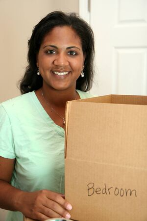 Family moving into a new home Stock Photo - 13301441