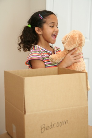Family moving into a new home Stock Photo - 13301584
