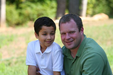 mixed race family: Father with his Son Stock Photo