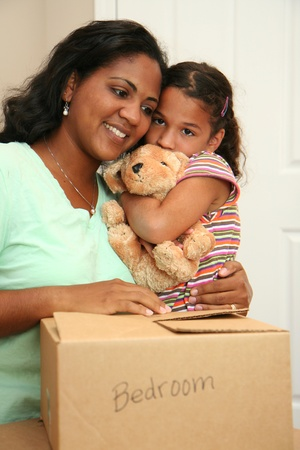 Family moving into a new home Stock Photo - 13299486