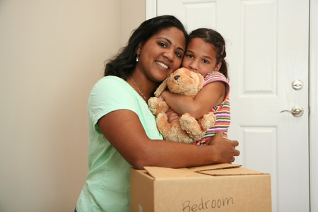 Family moving into a new home Stock Photo - 13301659