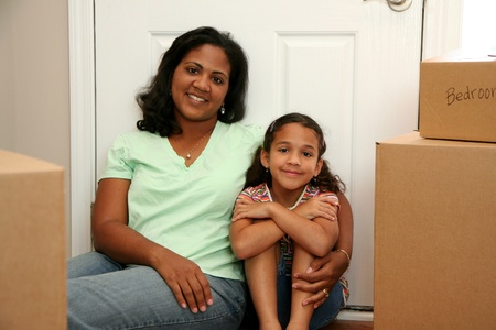 condominium: Family moving into a new home