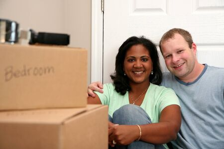 Family moving into a new home Stock Photo - 13299598
