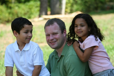 multiple family: A father with his children Stock Photo