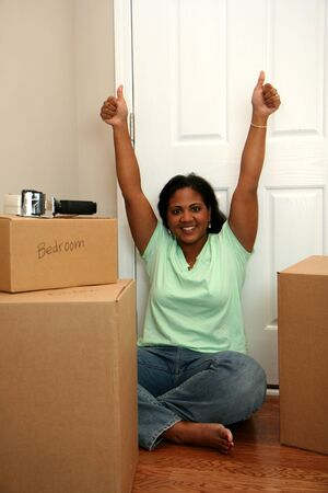 Family moving into a new home Stock Photo - 13299671
