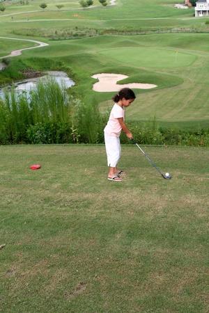 Child Golfing on Course photo