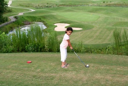 putt: Child Golfing on Course