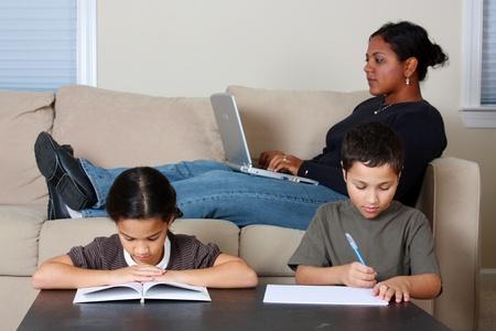 kids laptop: Minority woman and her children