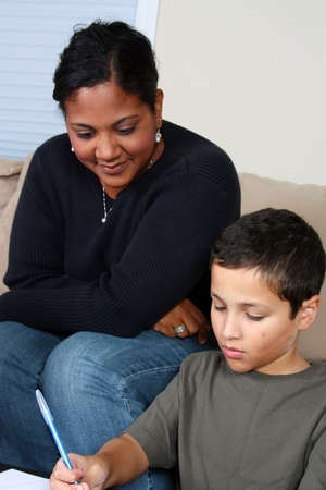 Minority woman and her son in their living room photo