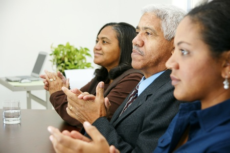 Team of business people working together in an office Stock Photo - 13294060