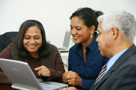 minority: Team of business people working together in an office Stock Photo