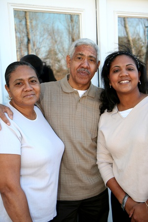 Minority family standing outside their new home Stock Photo - 13298047
