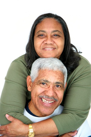 mature couple: Minority couple set against a white background