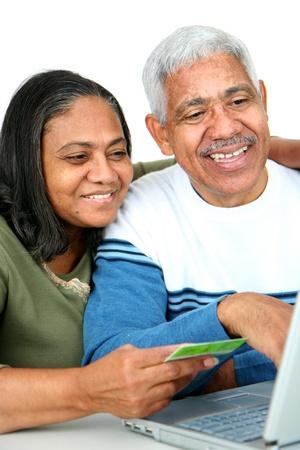 Minority couple set against a white background Stock Photo - 13298710