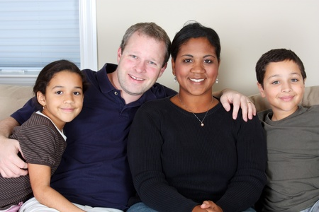 interracial family: Minority woman and her family in their home