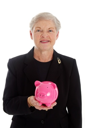 Senior Woman Holding A Pink Piggy Bank photo