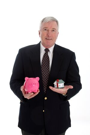Senior Man Holding A Pink Piggy Bank photo