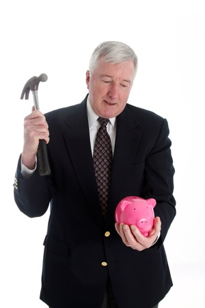 Man With Hammer and Bank Set Against A White Background photo