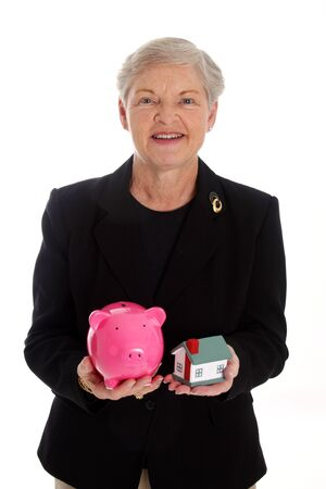 Senior Woman Holding A Pink Piggy Bank and Home photo