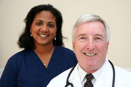 black nurse: Caucasian Doctor with minority Nurse Stock Photo